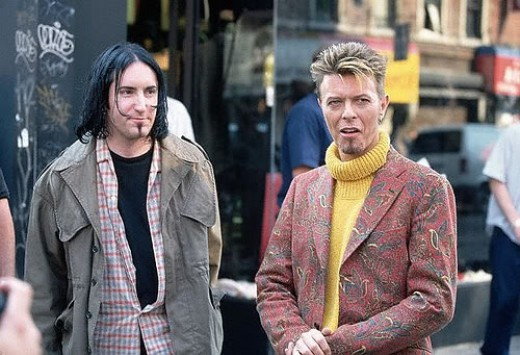 Trent Reznor posing with David Bowie during video production.