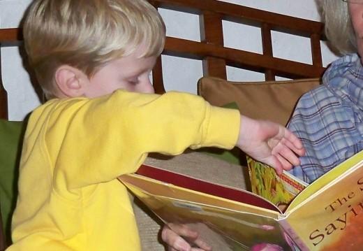 T shows Grandmama his favorite book.