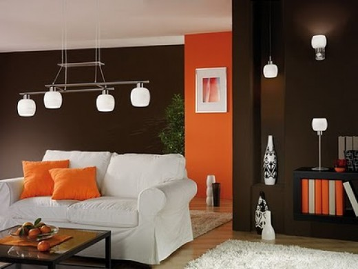 Modern, attractive, and affordable living room with two-toned paint and matching light fixtures.