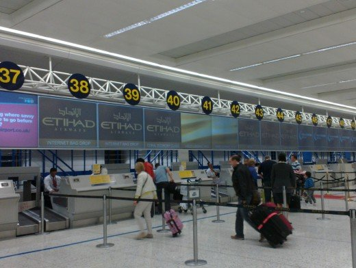 Check in desk for Etihad Airlines at Manchester Airport