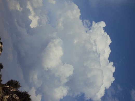 A billowy clouds looks like cotton in the sky of the San Bernardino Mountains.