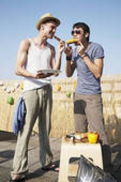 THESE GUYS ARE HAVING A GREAT TIME ENJOYING BURGERS AT A BARBECUE. YOU CAN TOO WITH MY RECIPE FOR 'HOBO HAMBURGERS.'