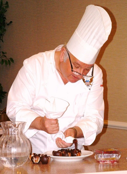 Chef Roland Mesnier demonstrates how to make raspberry chocolate dessert cups during a Chocolate Festival held in the Dover Downs Hotel in Dover, Delaware on 11/25/11.