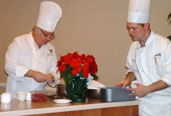 Chef Mesnier and assistant from Dover Downs Hotel making preparations for food demonstration at the Chocolate Festival.