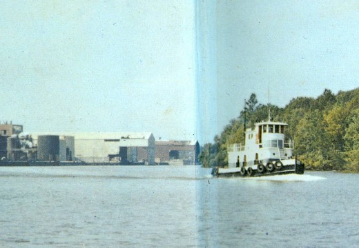 A tugboat on the Roanoke River, leaving the paper mill after delivering logs.