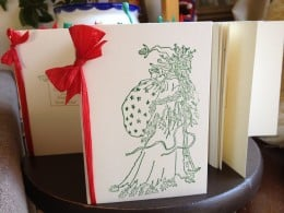 Using cream pre folded card, Chris Cringle stamp, green ink and red raffia.