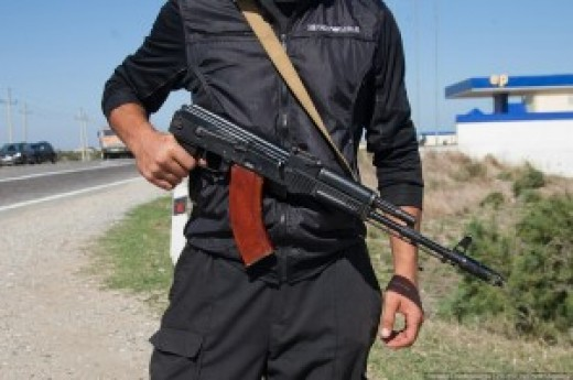 A Dagestan policeman - he can't allow his face to be shown (OK he might be pot ugly too, we don't know)
