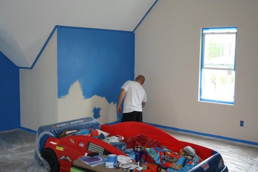 Boy's room taped and putting on the blue.