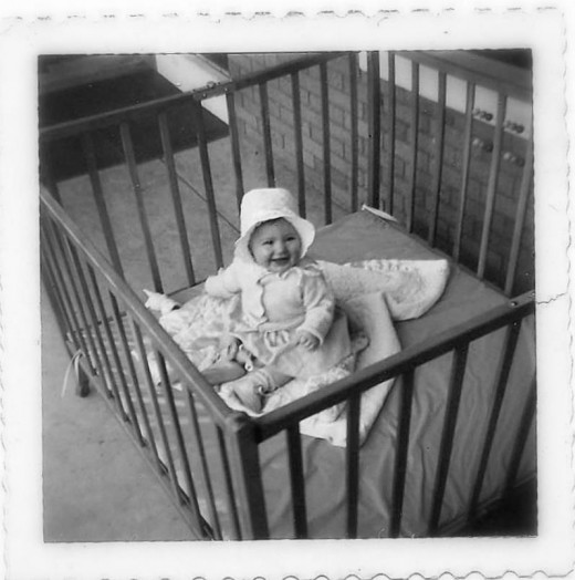 Me at 9 months old, on the porch for daily airing.