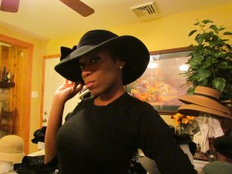 NeNe, models a black brim with a beautiful bow on the left side. Another style that we will see throughout the fashion industry this coming year.