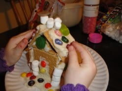 My daughter decorating her graham cracker house.  I let her do it however she pleased at 3 years old.