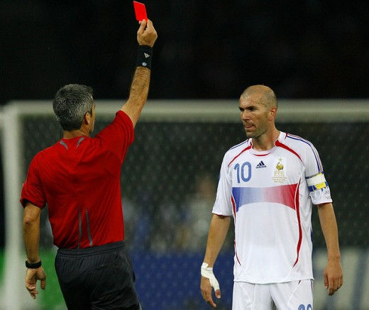 Referee Horacio Elizondo, of Argentina, shows the red card to France's Zineidine Zidane during the final of the soccer World Cup between Italy and France in the Olympic Stadium in Berlin, Sunday, July 9, 2006.