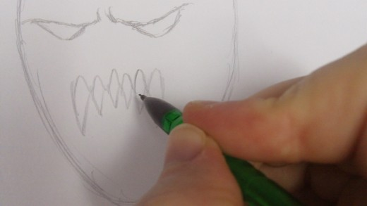 Drawing in the top teeth now.