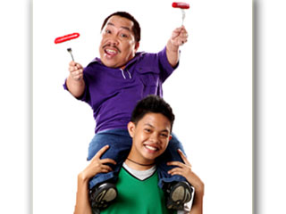 Midget actor Dagul, 53, doing a commercial on top of his 15-year old son John Clief