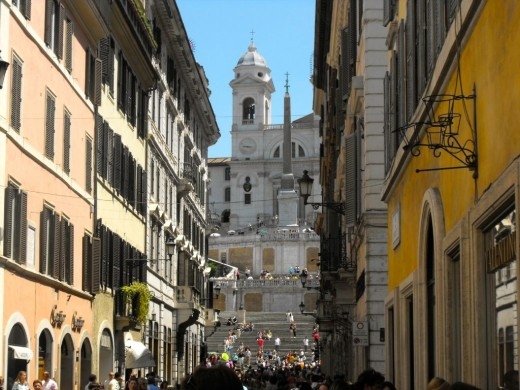 Thee designer street to shop in with a view up to Spanish Steps