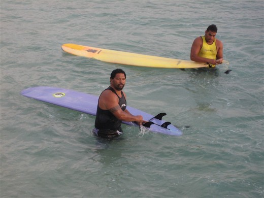 Surfers at Waikiki Beach