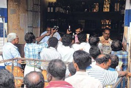 Disciplined long queue infront of a liquor shop in Kerala