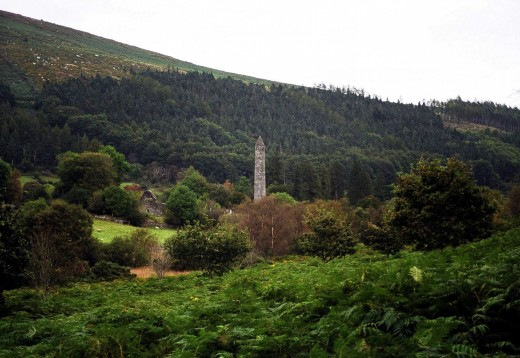 The round tower at Glendalough can be seen from a distance.