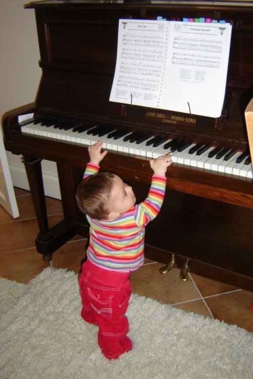 At only 9 months, she is already an accomplished pianist
