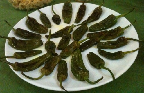 One of the many Pimientos de Padrón dishes prepared at my dinner table as an appetizer, in search of a fiery hot pepper