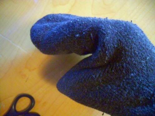 Use your hand to line the socks out even inside and out. Then form a sort of puppet like shape from the toe and heel of the socks.