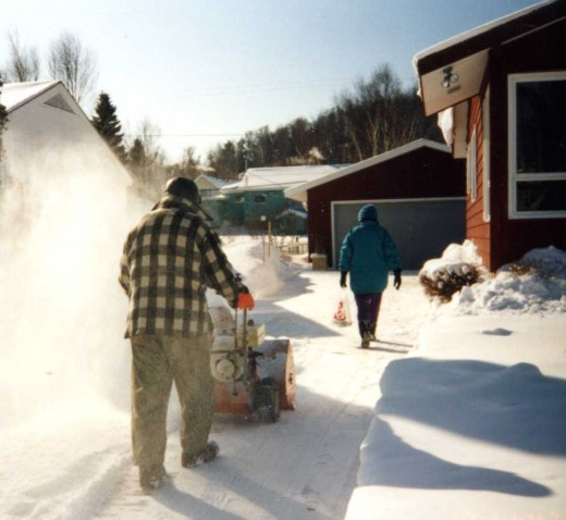 My Mom and Dad and the always ready snowblower in Munising circa 1994