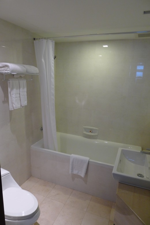 A nice full sized bathtub with Kohler bathroom fixtures