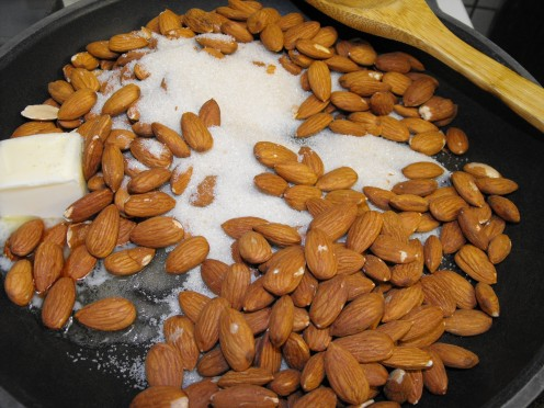 Combine almonds, sugar and butter in a nonstick pan.