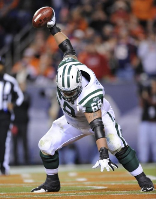 New York Jets offensive guard Matt Slauson (68) reacts after recovering a fumble in the endzone for a touchdown against the Denver Broncos in the third quarter of an NFL football game, Thursday, Nov. 17, 2011, in Denver. (AP Photo/Jack Dempsey)