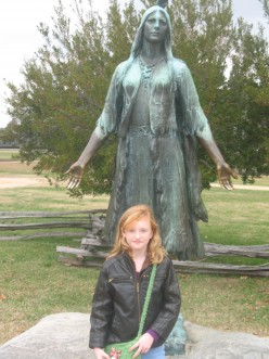 My daughter Haley standing in front of Pocahantas statue at Jamestown Settlement on the banks of the James River