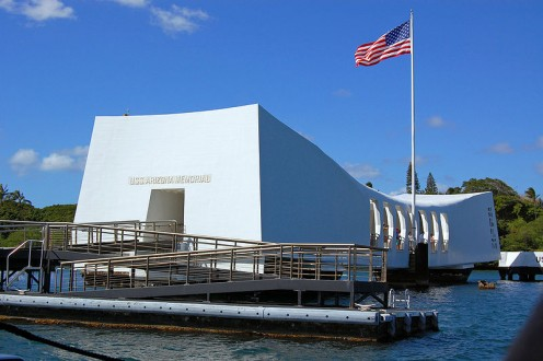USS Arizona Memorial. The ship is sunken and beneath the building. Visitors can see it from the memorial.