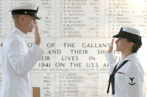 Journalist 3rd Class Sunday Williams of Navy Region Hawaii Public Affairs, reenlists in shrine room on USS Arizona Memorial by her leading CPO, Chief Journalist Tim Paynter. Engraved on the shrine room wall are the names of 1,177 Sailors and Marines