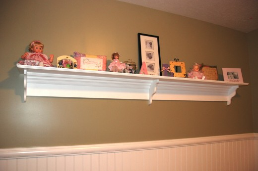 Custom-made, decorative shelf brackets add style and detail to an otherwise plain shelf.