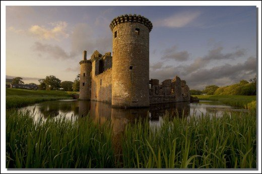Caerlaverock Castle - a red sandstone medieval castle with moat in the Scottish borders.