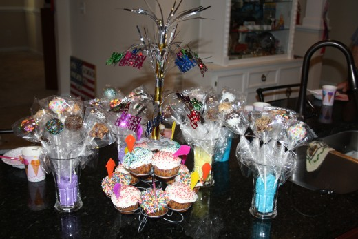The cake pops and cupcakes all decorated and ready for the party.
