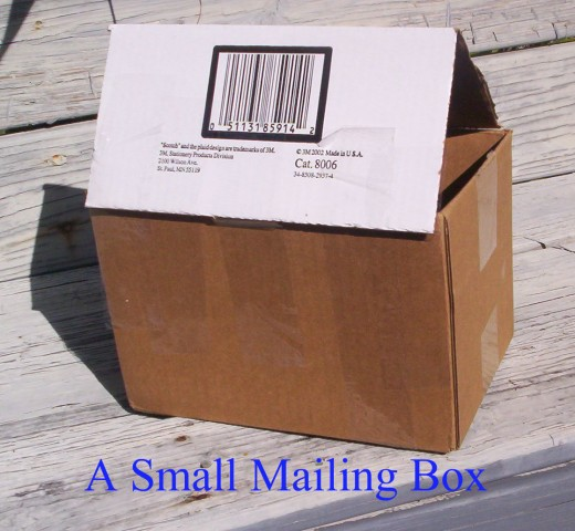 A small cardboard mailing box can be used for a Gingerbread House.