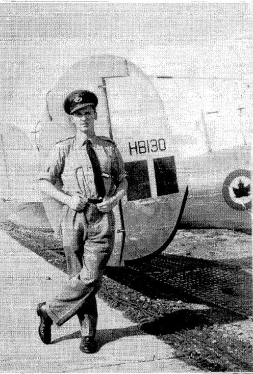 My father by his first RCAF plane.
