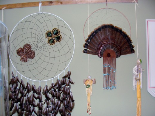 Dream catchers made of feathers and animal skin.