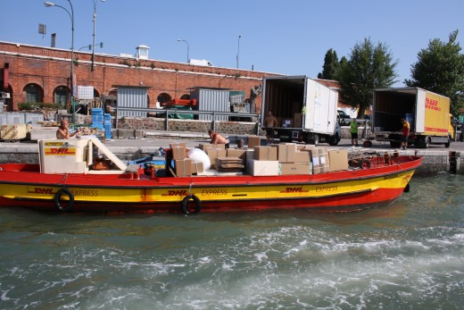 DHL delivers in Venice Italy!  Notice the workers are wearing no shirts, they wouldn't get by with that here in the states.
