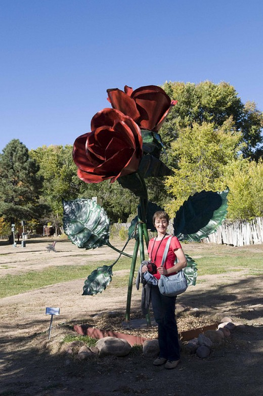 ROSES ARE FINE TO GIVE TO A GIRL, BUT A STATUE OF A ROSE THAT IS FOUR TIMES TALLER THAN SHE IS?