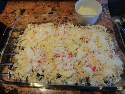 Spread 1/2 of the Mozzerella and 1/2 of the Swiss cheeses on top.