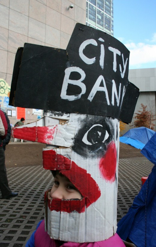 A mask that depicts CitiBank as a chicken (mask courtesy of Bread & Puppets)