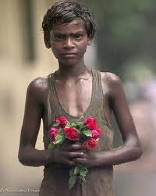 In Calcutta, India.  Boy going to Mother's Funeral