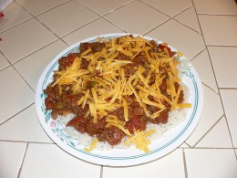 Here is one really delicious way to serve the Texas Green Pepper Chili. Serve it over white buttered rice and top it with shredded cheddar cheese. Along with a delicious square of corn bread you won't find a much better meal.