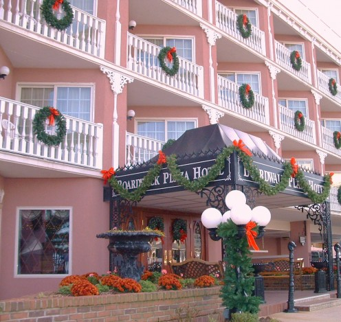 At Christmas time every street side balcony is decorated by a wreath and the old world lamp posts are wrapped in evergreen garlands and bright red bows.