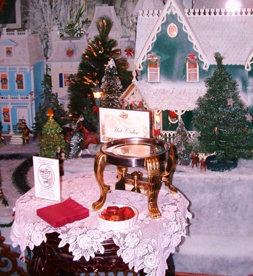 Hot cider stand and Victorian display in lobby.