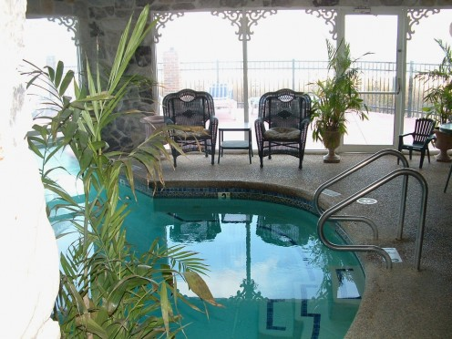 Heated Indoor spa pool with view of outside pool, deck and ocean. The spa pool is reserved for adults only in the evenings. Guests of any age may use it in the daytime.