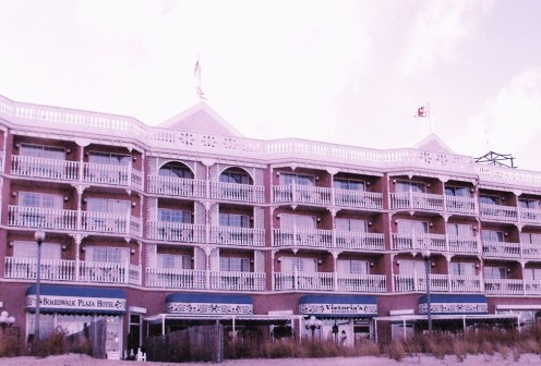 Ocean front rooms and suites with private balconies are available at the Boardwalk Plaza Hotel. Victoria's Restaurant also has a boardwalk entrance which can be seen to the right. In warm weather there is outdoor seating under the two large canopies.