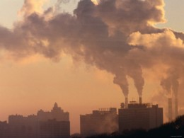 Skyline View of Industrial Factory While Emitting Pollution at Sunset