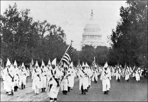 1925, the KKK at the height of its power marches on Pennsylvania Ave., Washington, D.C.